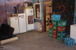 3 από τα ψυγεία και τα καφάσια με κενές φιάλες του καφενείου